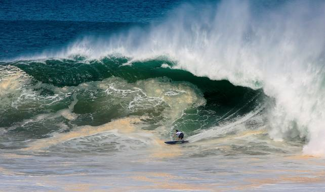 Grant 'Twiggy' Baker charges an unruly 10 metre wave on his way to the semifinals of the Puerto Escondido Challenge in Mexico on Friday Photo: WSL / Hinkle